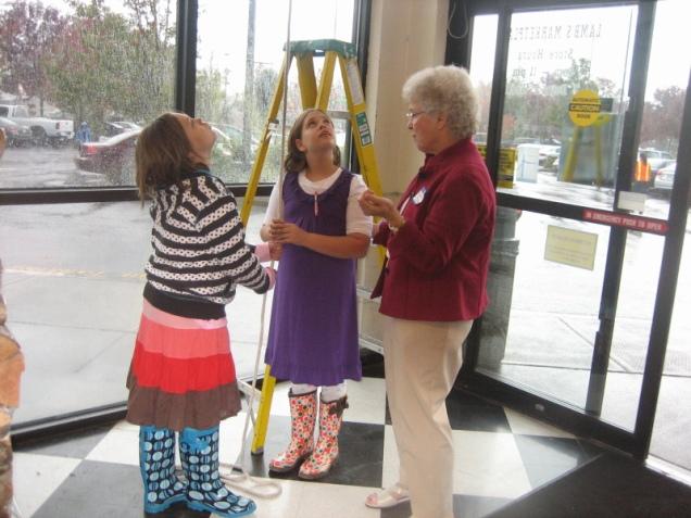 Elaine Shreve with bell ringers