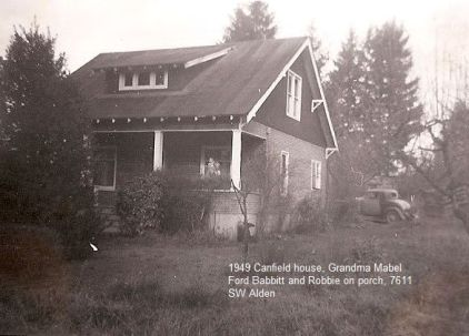 1949 Canfield house. Grandma Mabel Ford Babbitt and Robbie on porch.