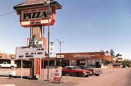 1994 photo of the Big Tomato Pizza Company sign in the parking lot of Lamb's Thriftway shopping plaza.