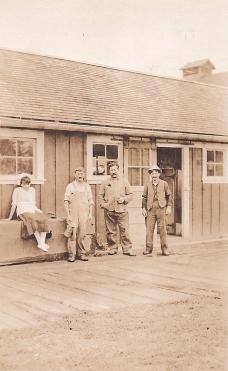 Shattuck Dairy - girl, 3 men shop door open