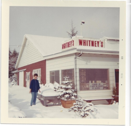 Whitney's Cannery - Leona Whitney and CHEER UP IT MUST BE COLDER IN ALASKA sign 1969