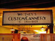 Original Whitney's Custom Cannery sign inside the Old Market Pub and Brewery