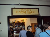 Whitneys Custom Cannery sign hanging in the Old Market Pub and Brewery