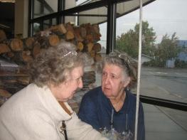 Zora and Sharka ringing the bell at Lambs Thriftway