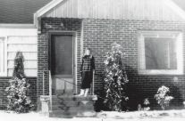 Dorothy in front of house, 1950s