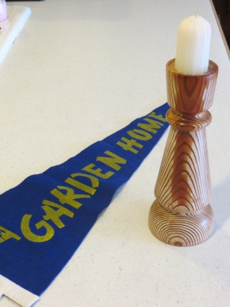 Old pennant and a candlestick made of wood from original Garden Home School