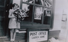 1945 Dorothy Johnson in front of Gust Johnnson's gas station, FDR death