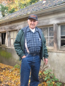 Bob Feldman beside original milking barn, 2011