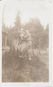 Roderick MacKay working on a stump with son Darrell