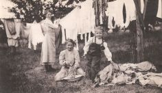 Wash day, Elsie, Ida and Frieda Von Bergen hanging out the wash (vintage photo)