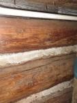 Log house, chinks, with bark
