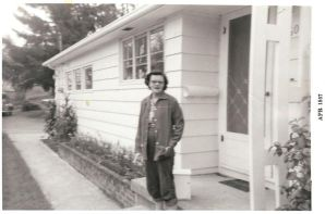 Mildred Ransom in front of 4608 SW Maplewood Rd house