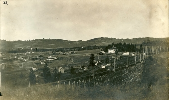 Maplewood trestle for the Oregon Electric Railway. Note Maplewood School in background.