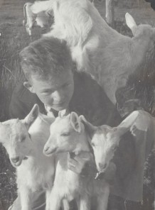 Jack Godwin with goats. Favorite goat Pete on far right.