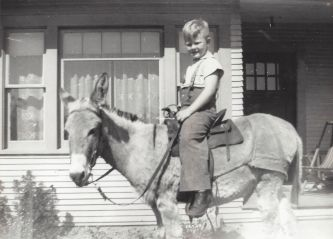 Jack Godwin on Babe the burro in front of Godwin home on Westgard Ave (now SW 87th)