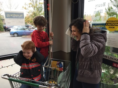 Ringing the bell at the Garden Home Market Place, 2015.
