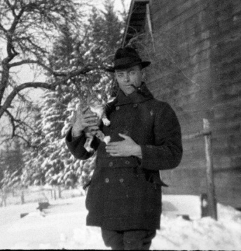 Melvin Replogle and cat in snow, 1920s