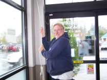 Jan Fredrickson ringing the bell inside Lamb's Marketplace