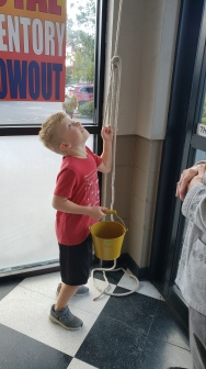 2019 Bell Ringing - Kid with pail