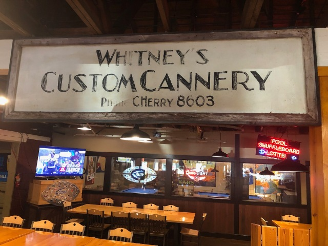 The original Whitney's Cannery sign on display in the Old Market Pub